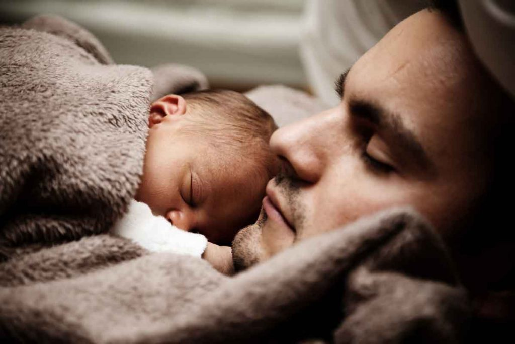 cute-baby-sleeping-with-dad-upclose-shot